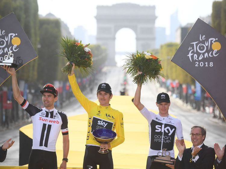 Geraint Thomas (C)  following the 21st and final stage of the 105th edition of the Tour de France cycling race