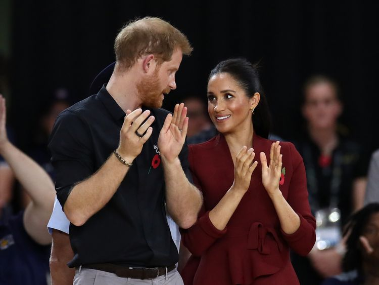 Prince Harry, Duke of Sussex and Meghan, the Duchess of Sussex participate in the medal ceremony following the gold medal match of the Wheelchair Basketball between the Netherlands and the United States during day eight of the Invictus Games Sydney 2018 at The Quay Centre on October 27, 2018 in Sydney, Australia