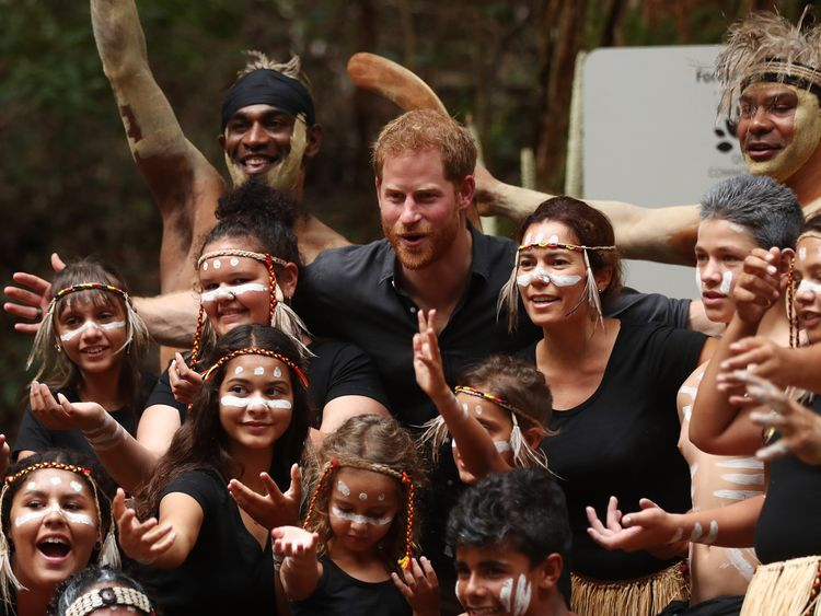 The Duke of Sussex poses for a group photograph with tribe of K'gari in the Queens Canopy