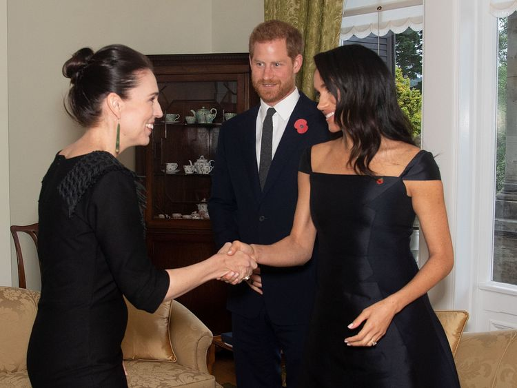 Britain's Prince Harry and his wife Meghan, the Duchess of Sussex meet with New Zealand's Prime Minister Jacinda Ardern during a visit to Government House in Wellington
