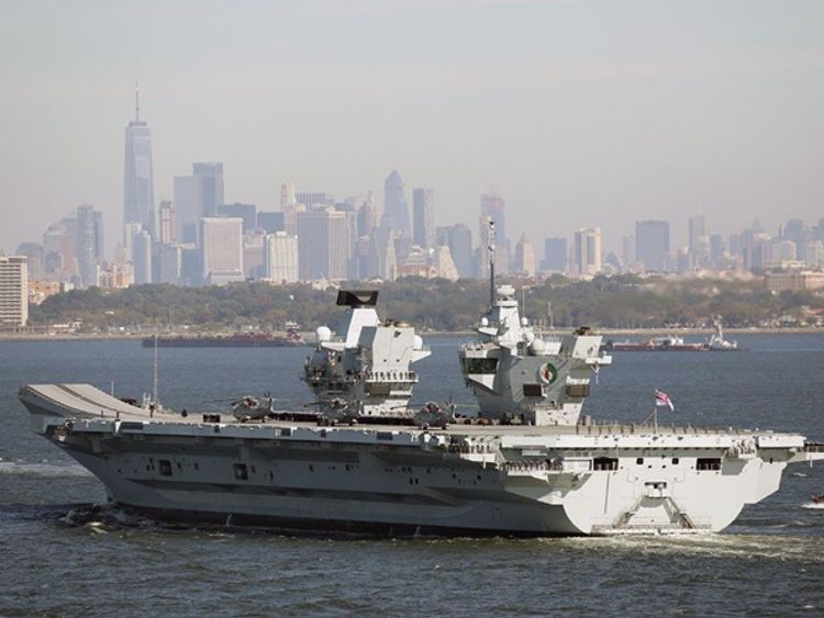 HMS Queen Elizabeth sails by the iconic New York skyline