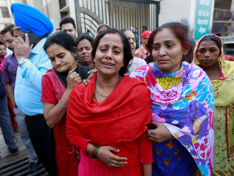Anguished relatives cry after seeing the body of a loved one