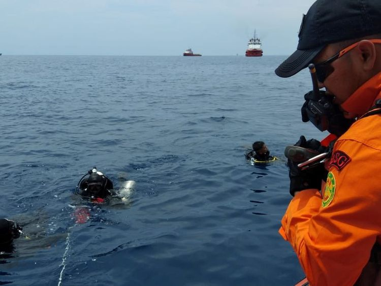 Rescue workers are seen at the site where it is believed the Lion Air flight JT610 crashed