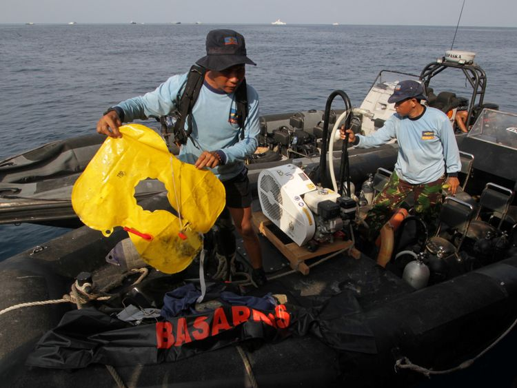 An Indonesian Navy member holds an airplane lifejacket recovered after Lion Air's, flight JT610 sea crash, off the coast of Karawang regency