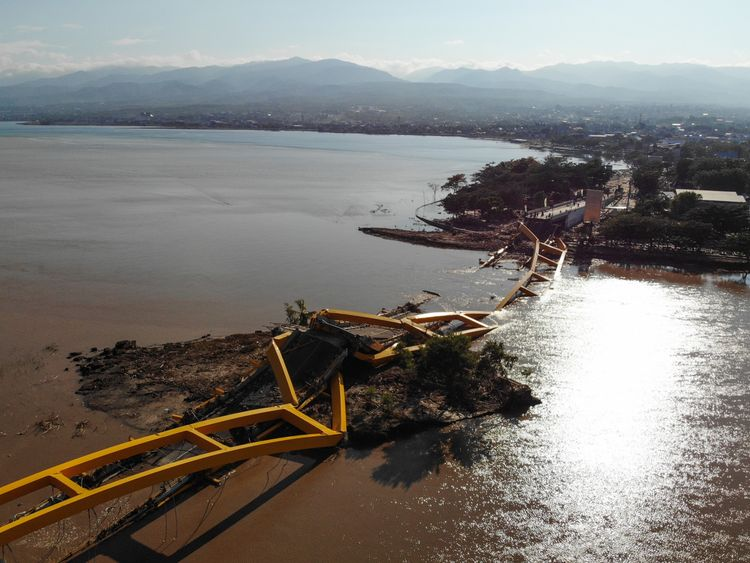 A bridge has collapsed in Palu, where most of the dead have so far been found