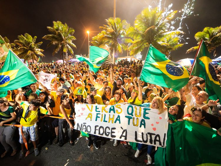 Supporters of Jair Bolsonaro, celebrate his win in front of his house in Rio de Janeiro