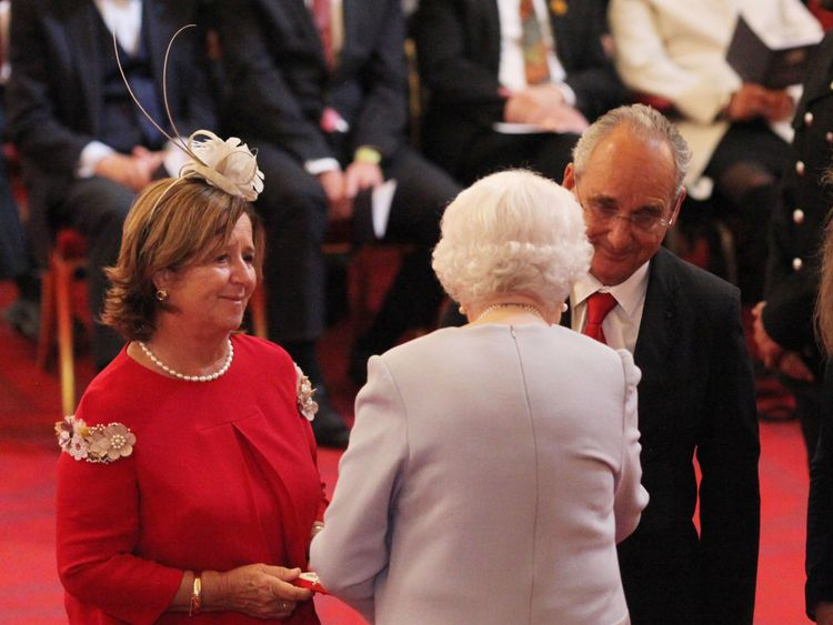 Joaquin Echeverria Alonso and Maria Miralles De Imperial Hornedo receive the George Medal awarded to their late son, Ignacio Echeverria, from Queen Elizabeth II