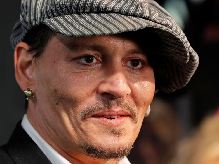 Actor Johnny Depp arrives before presenting his recent movie Richard Says Goodbye during the 14th Zurich Film Festival