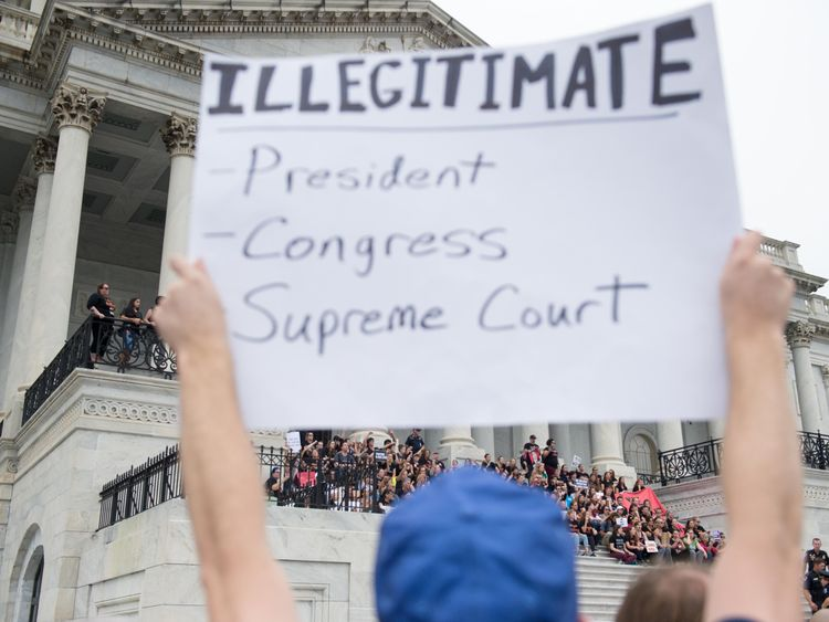 Protestors outside the Supreme Court ahead of Justice Kavanaugh's official swearing-in