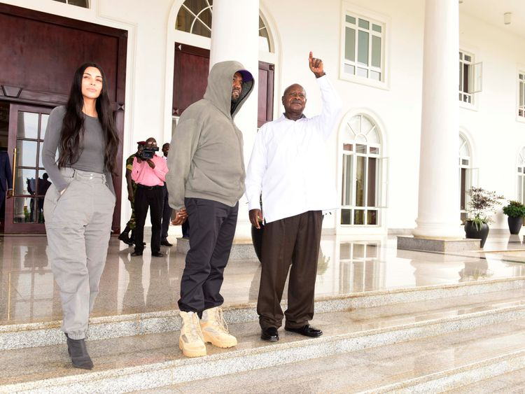 (L-R): Kim Kardashian, Kanye West and Uganda's President Yoweri Museveni
