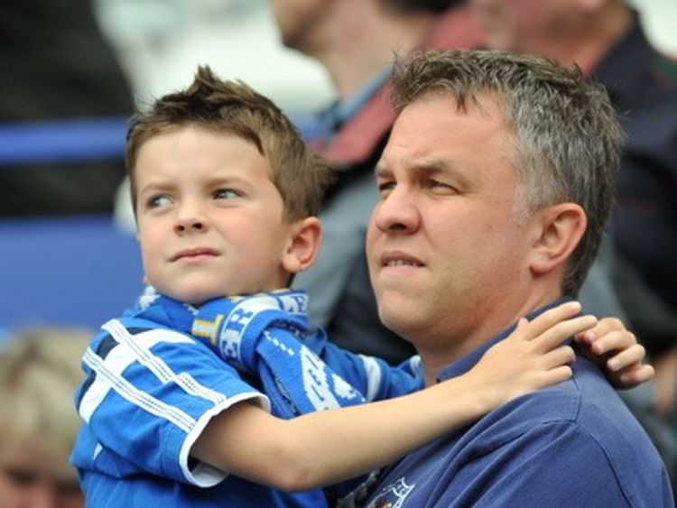 Leicester City fan and journalism lecturer Lee Marlow with his son Lucas at a game
