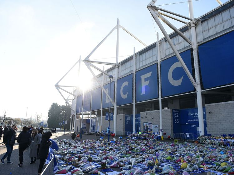 Flowers are laid out next to the club's grounds