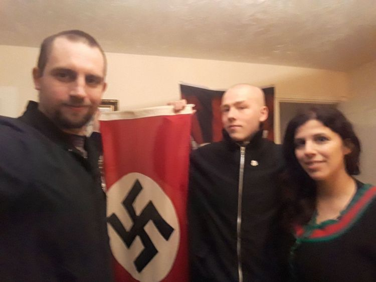 Photo issued by West Midlands Police showing Darren Fletcher (L) who has admitted being a member of National Action, posing with alleged members Adam Thomas and his partner Claudia Patatas
