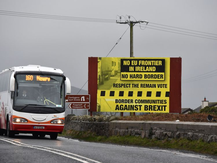 NEWRY, NORTHERN IRELAND - FEBRUARY 02: A bus crossing along the border between Northern and southern Ireland passes a sign campaigning against a so called hard Brexit, on February 2, 2017 in Newry, Northern Ireland.