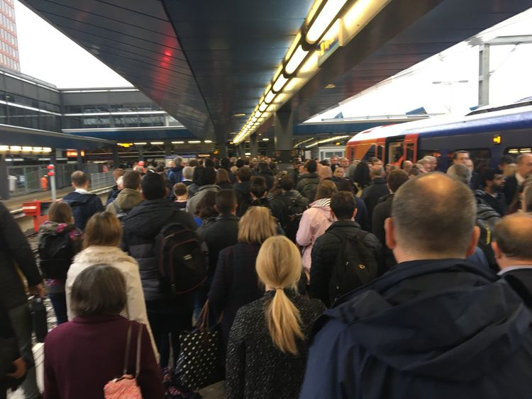 Commuters at Reading station following ongoing problems at Paddington Station