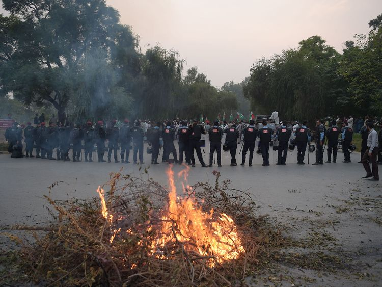 Pakistani riot policemen lineup on a blocked street leading to Pakistan's Supreme Court