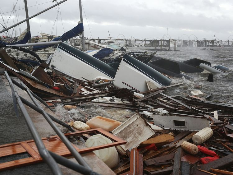 Boats that were docked are seen in a pile of rubble after hurricane Michael passed through the downtown area on October 10, 2018 in Panama City, Florida