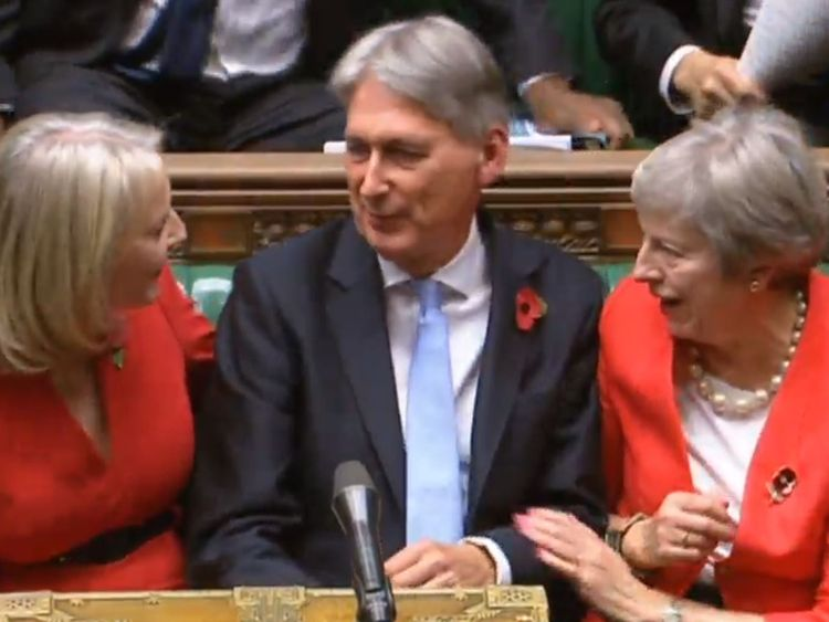Chief Secretary to the Treasury Liz Truss (left) and Prime Minister Theresa May congratulate Chancellor of the Exchequer Philip Hammond as he finishes making his Budget statement to MPs in the House of Commons, London.