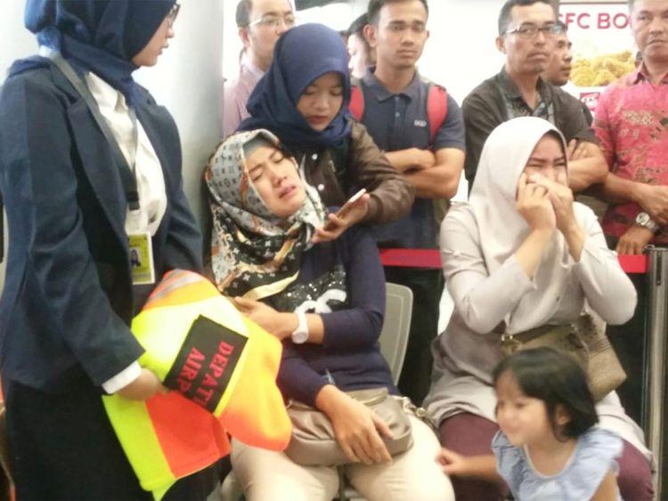 Relatives of passengers wait for news