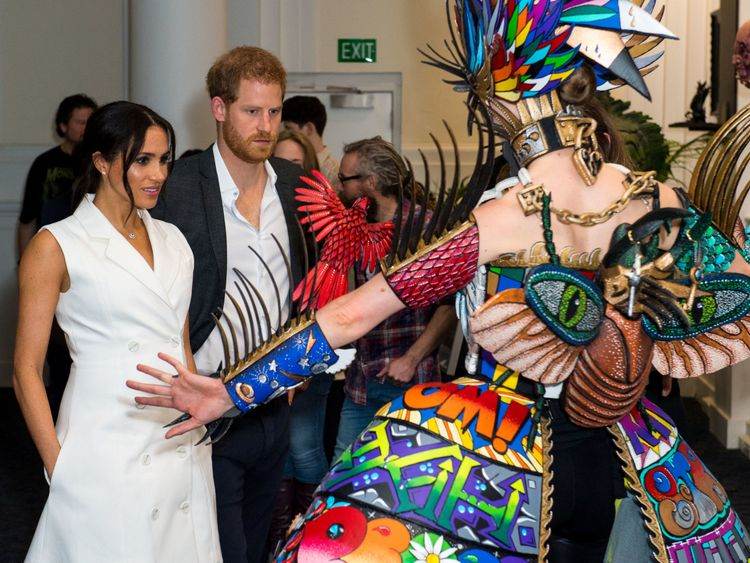 Prince Harry and Meghan, Duchess of Sussex, meet actors in costumes during a visit to Courtenay Creative, in Wellington, New Zealand