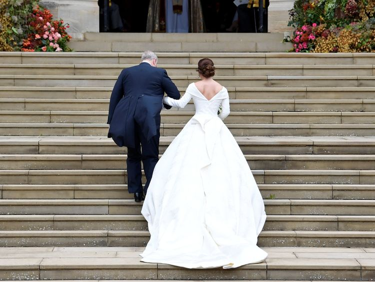 Princess Eugenie arrives accompanied by her father Prince Andrew, Duke of York, at St George's Chapel