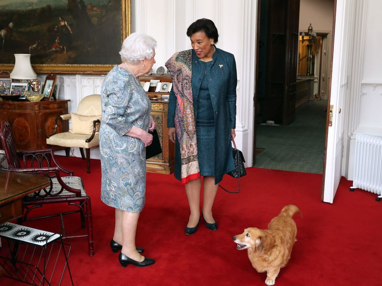 The Queen meeting Baroness Scotland with one of her dogs at Windsor Castle