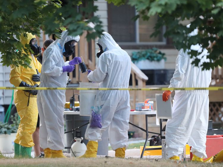 FBI investigators wear hazmat suits to enter the house in Utah