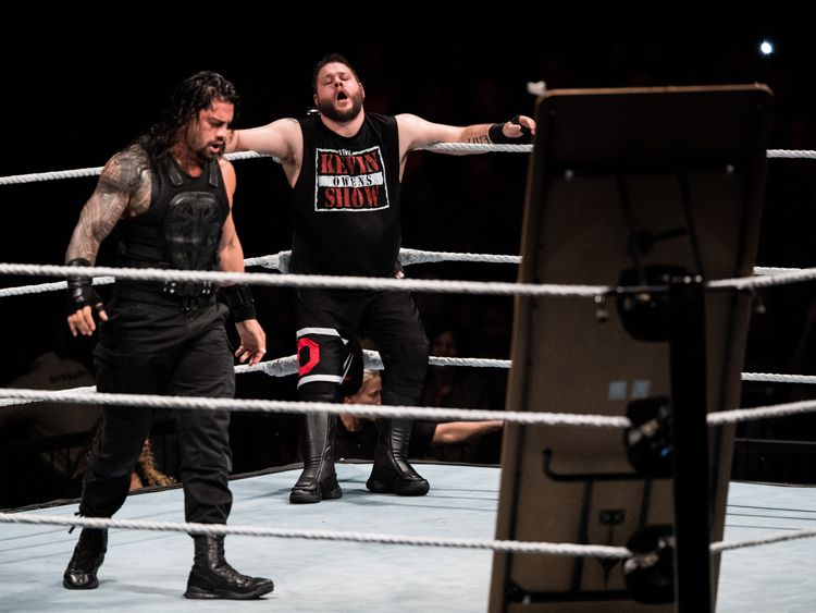 Roman Reigns (L) during a 2017 WWE Live Duesseldorf event with Kevin Owens