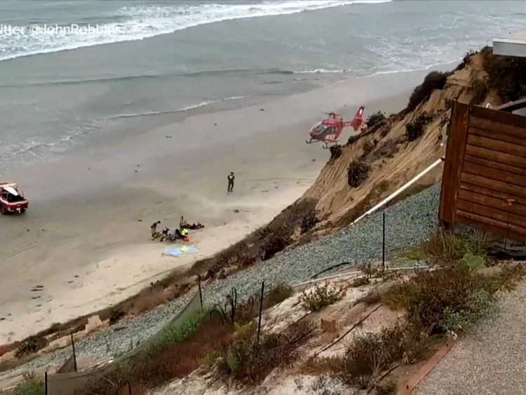 A helicopter landed on the beach. Pic: Twitter/ @JohnRobbins