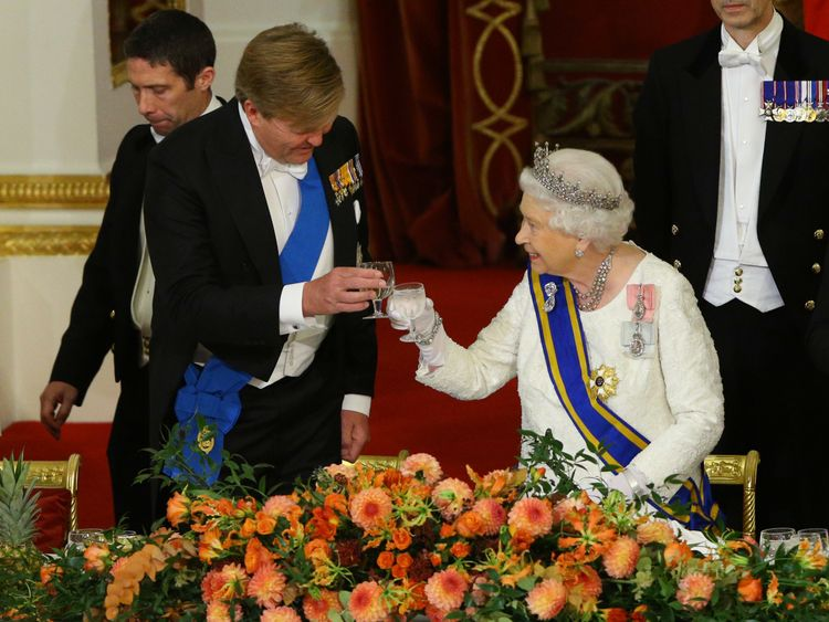 The Queen makes a toast during with King Willem-Alexander during the state banquet at Buckingham Palace