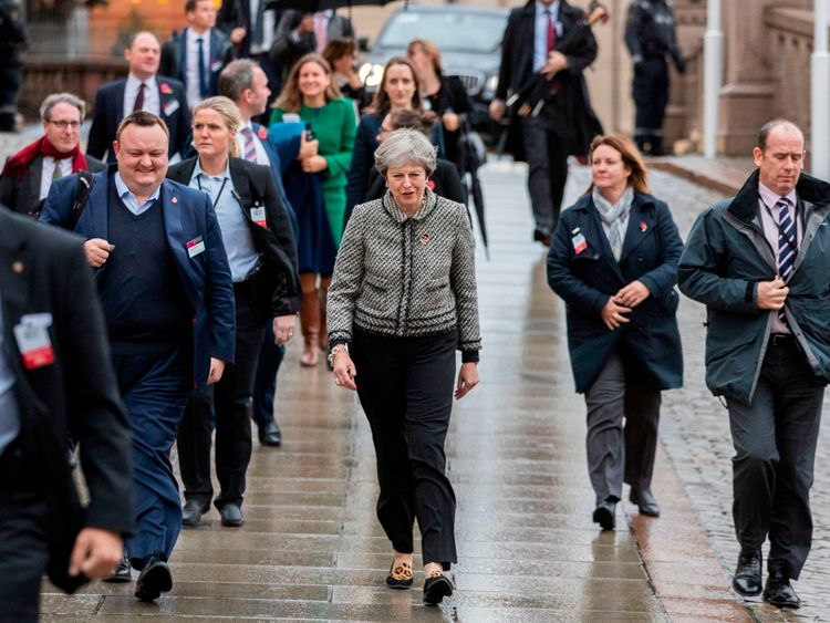 British Prime Minister Theresa May walks through the rainy streets of Oslo on the sidelines of a session of the Nordic Council on October 30, 2018. - The Council session runs until November 1, 2018. (Photo by Hakon Mosvold LARSEN / NTB Scanpix / AFP) / Norway OUT (Photo credit should read HAKON MOSVOLD LARSEN/AFP/Getty Images)