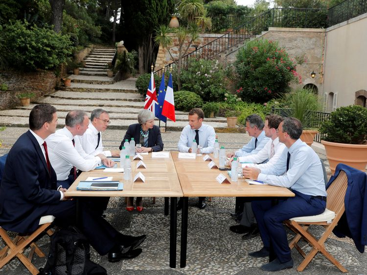 Olly Robbins (left) with the prime minister as she met French president Emmanuel Macron in August