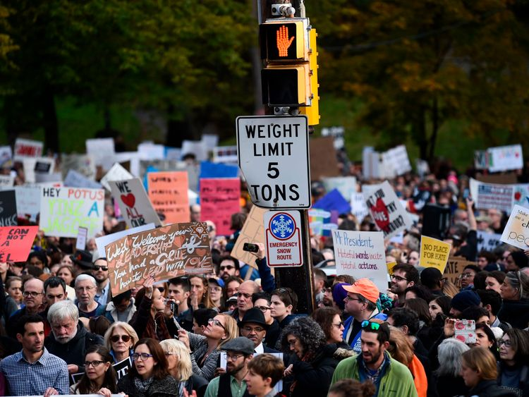 People protest the arrival of US President Donald Trump as he visits the Tree of Life Congregation on October 30, 2018 in Pittsburgh, Pennsylvania