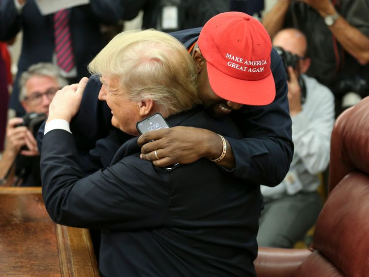 Kanye West hugs Donald Trump during their White House meeting