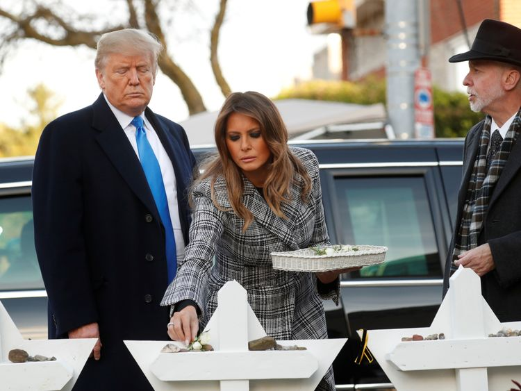 U.S. President Donald Trump and first lady Melania Trump place stones on a memorial to shooting victims as they stand with Tree of Life Synagogue Rabbi Jeffrey Myers outside the synagogue where a gunman killed eleven people and wounded six during a mass shooting in Pittsburgh, Pennsylvania, U.S.