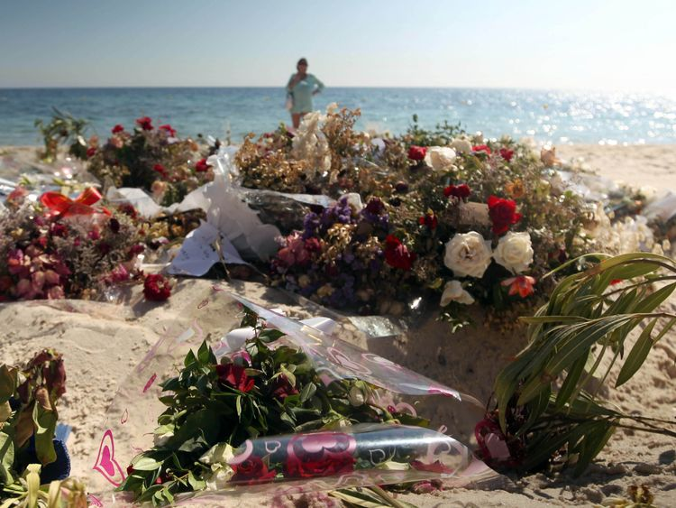Flowers remain on the beach near the RIU Imperial Marhaba hotel in Sousse, Tunisia,