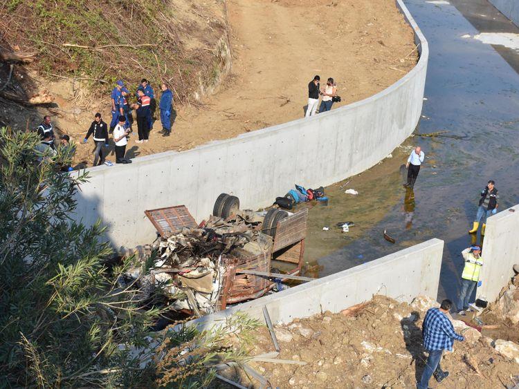 Children among 22 dead as truck crashes off bridge