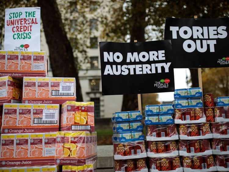 A protester stages a food bank demonstration on Whitehall complete with tons of packaged food against the Government's Universal Credit programme on November 21, 2017