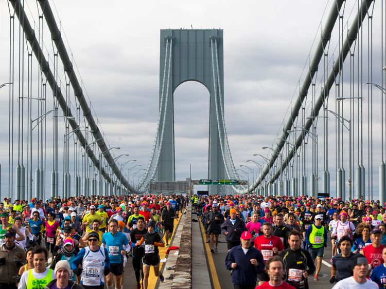 Runners cross the Verrazano-Narrows Bridge during the New York City Marathon in New York, November 3, 2013