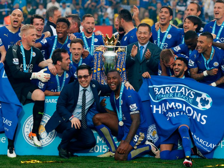 Aiyawatt Srivaddhanaprabha (2L) jokes with Leicester City's English defender Wes Morgan (C) as Leicester players celebrate with Leicester City's Thai chairman Vichai Srivaddhanaprabha (C-R) with the Premier league trophy after winning the league and the English Premier League football match between Leicester City and Everton at King Power Stadium in Leicester, central England on May 7, 2016