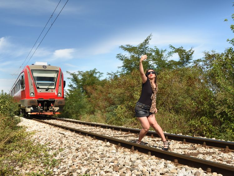 Woman taking dangerous selfie on railway track. File pic