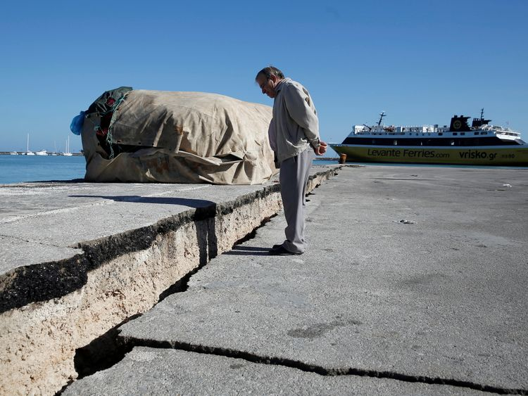 A man looks at the damaged pier of the port of Zakynthos, following an earthquake off the Zakynthos Island, Greece, October 26, 2018. REUTERS/Costas Baltas