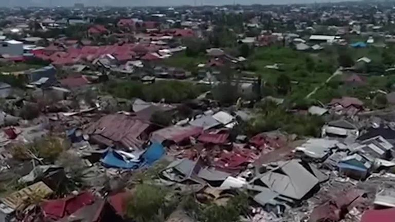 low flying drone shot showing destruction in the Petobo area of Palu city, which suffered heavy damage from last week's natural disaster