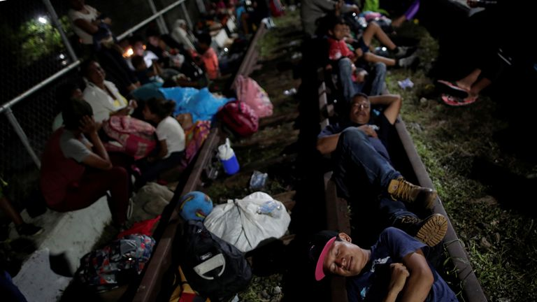Migrants sleep on a bridge approaching the Guatemala-Mexico border