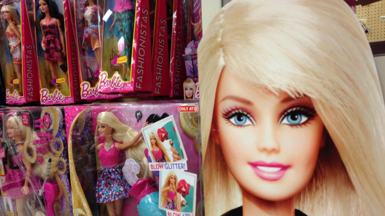 Barbie dolls are shown in the toy department of a retail store in Encinitas, California October 14, 2014.