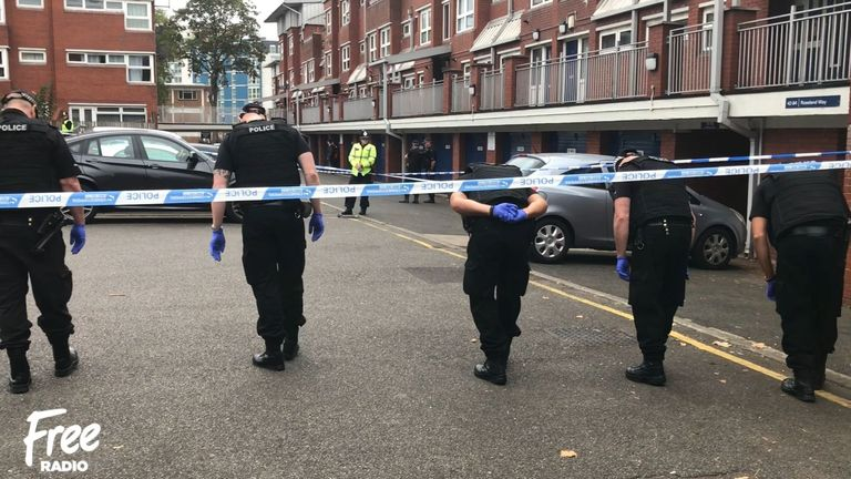 Police at the scene where a man was shot during a raid. Pic: Free Radio, Birmingham
