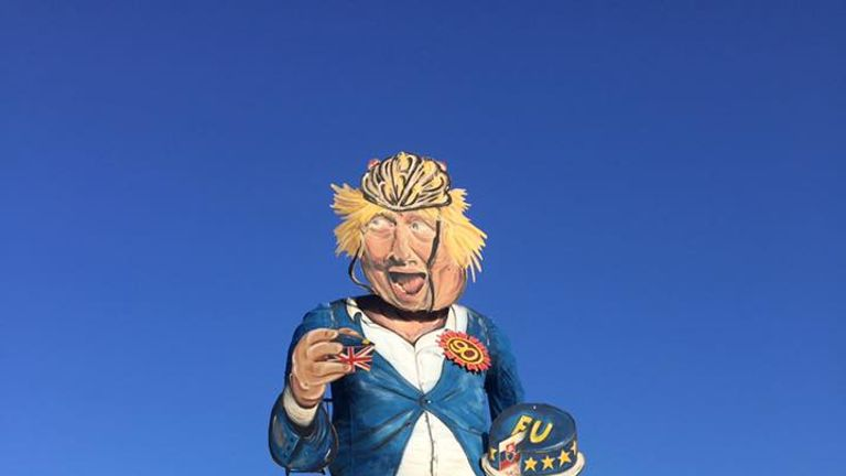 The effigy boasts a heavy Brexit theme, including an EU cake. Pic: Edenbridge Bonfire Society