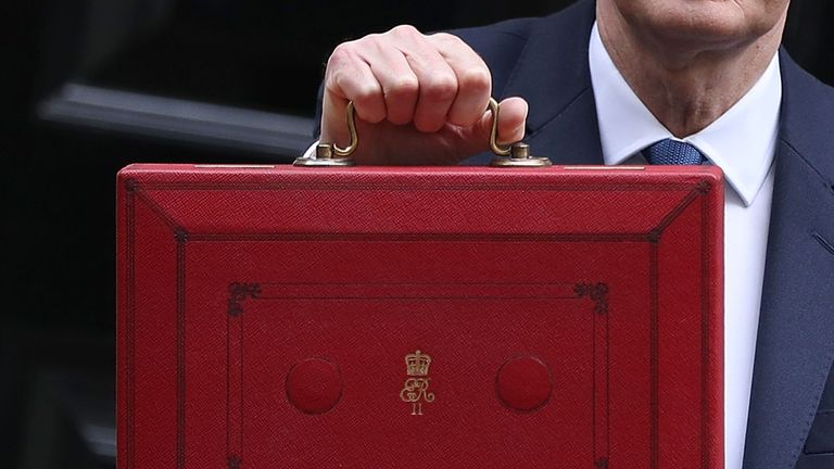 LONDON, ENGLAND - MARCH 08:  Chancellor of the Exchequer Philip Hammond holds the budget box up to the media as he leaves 11 Downing Street on March 8, 2017 in London, England. Today's Budget will be the last one to take place in the spring. It is being replaced by an annual autumn Budget, the first of which is to be held later this year. The current Chancellor wants to simplify the process of setting taxes and government spending.  (Photo by Dan Kitwood/Getty Images)