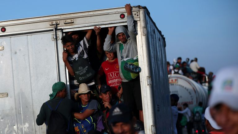 Many of the migrants are travelling squished into lorries or on top of them
