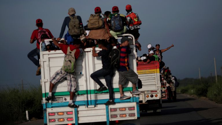 Migrants hitchhike on a truck from San Pedro Tapanatepec in Oaxaca, southern Mexico
